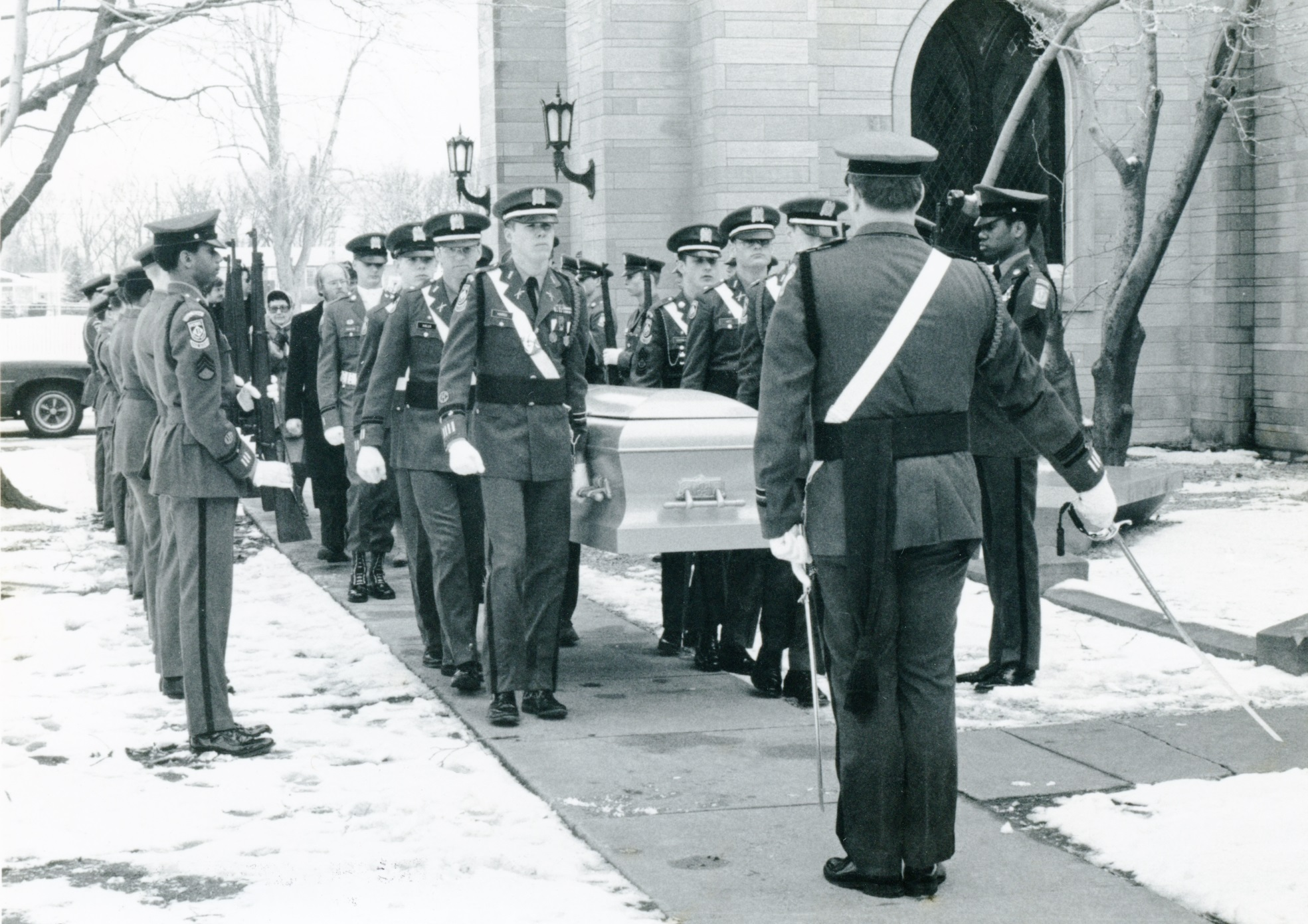 Cadet pallbearers carry the casket of Bishop Walter Conrad Klein into the Crypt for burial